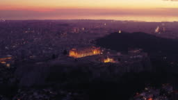 Parthenon Acropolis, Athens, Greece, dark purple hour, sunset by drone