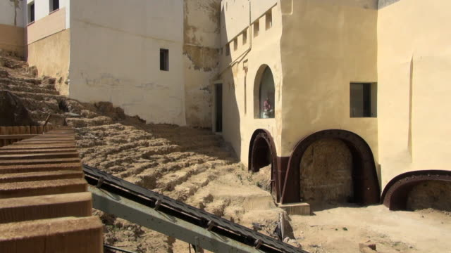 partial outside view of roman theatre of cadiz - 荒廃した点の映像素材/bロール