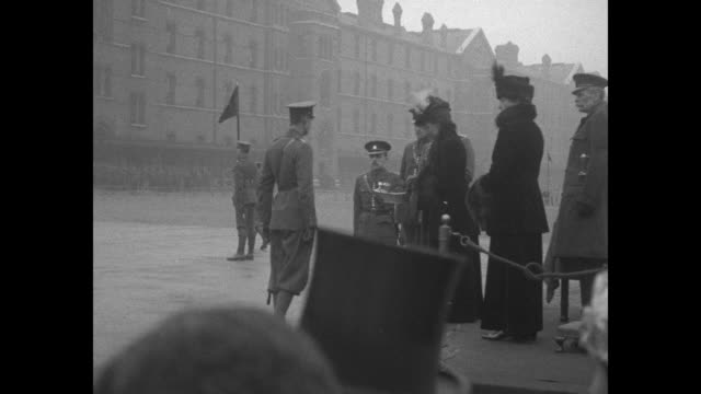partial side view, queen alexandra of denmark hands out shamrocks to british soldiers of the irish guards / queen watch troops parade past - 1920 stock videos & royalty-free footage