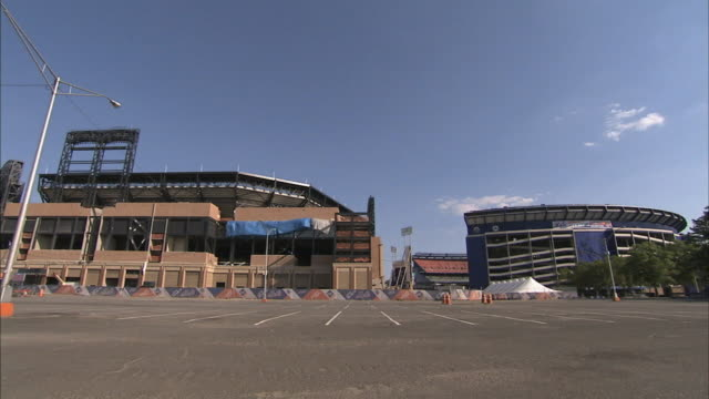 ws partially completed citi field under construction next to shea stadium w/ parking lot fg no people ballpark baseball park venue citigroup queens... - flushing meadows corona park stock videos and b-roll footage