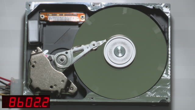 partially-dismantled computer hard disc drive being illuminated with a high-speed stroboscope. - ディスク点の映像素材/bロール