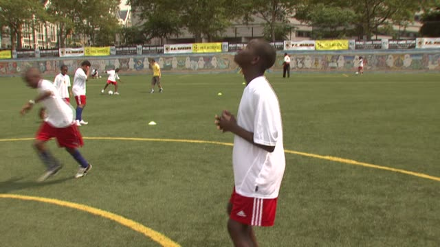 a participant at the youth soccer clinic at jacob h schiff playground in new york new york on august 18 2007 - participant stock videos and b-roll footage