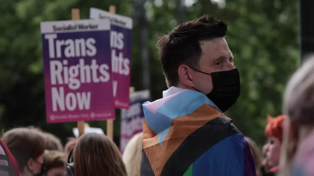 participant at trans+ pride march on june 26, in london, england. - marching stock videos & royalty-free footage