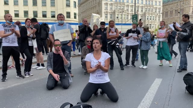 participant gets on her knees during a demonstration against the government measures to slow down the spread of coronvirus on april 24, 2020 in... - participant stock videos & royalty-free footage