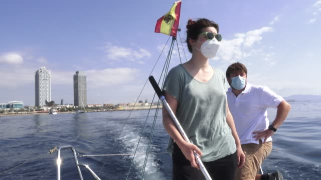 participant helga as helmswoman takes course 330º as participants in face masks sit on board a boat where three has been a reduction in the number of... - participant stock videos & royalty-free footage