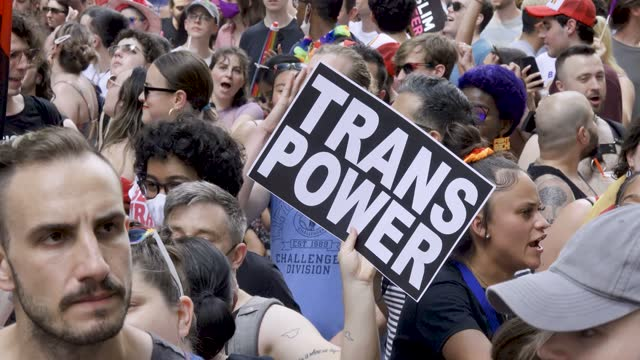 """participant holds a sign that reads """"trans power"""" as they take part in the queer liberation march to celebrate lgbtq pride month on june 27, 2021 in... - pride stock videos & royalty-free footage"""