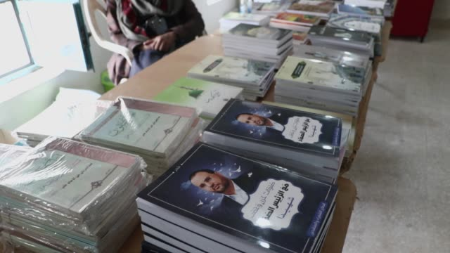 a participant in a book exhibition sits by his variety of books waiting for customers amid lack of visitors on september 23 2020 in sana'a yemen the... - participant stock videos & royalty-free footage