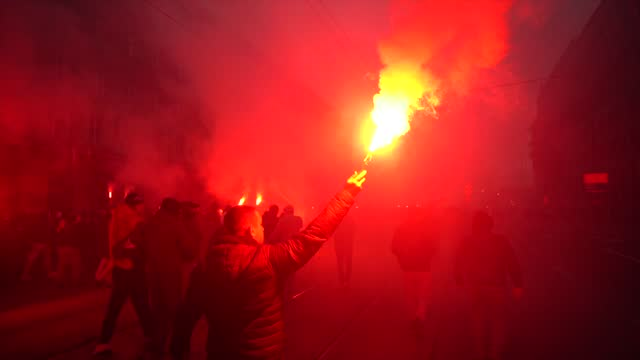 participant in the independence day march holds a flare in warsaw, poland on november 11, 2020. participants in the independence day march, mostly... - participant stock videos & royalty-free footage
