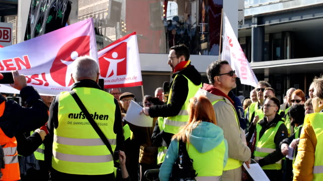 """participant speaks at the rally. supporters of the new left-wing """"stand up"""" movement gather at a demonstration at potsdamer platz on february 16,... - participant stock videos & royalty-free footage"""