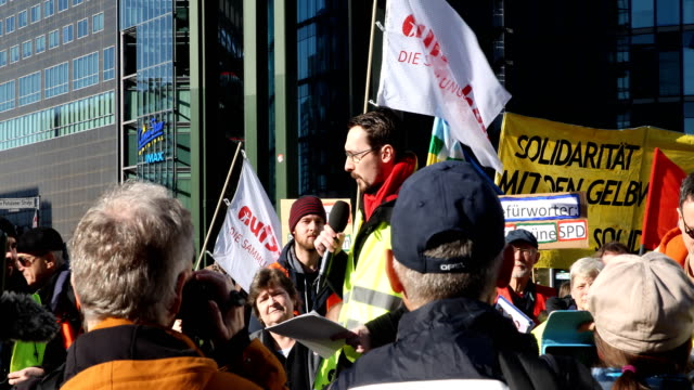 a participant speaks at the rally supporters of the new leftwing stand up movement gather at a demonstration at potsdamer platz on february 16 2019... - participant stock videos & royalty-free footage