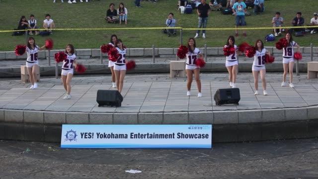 yokohama kanagawa prefecture japan june 3 2017 a participant team of cheerleaders dance on the stage of yes yokohama entertainment showcase as a part... - チアリーダー点の映像素材/bロール