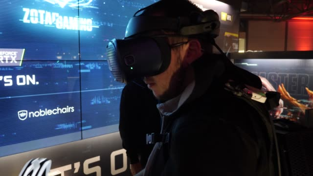 participant uses a vr-glases to play a video game at computers play networked computer games during a lan party in the expo area at the dreamhack... - participant stock videos & royalty-free footage