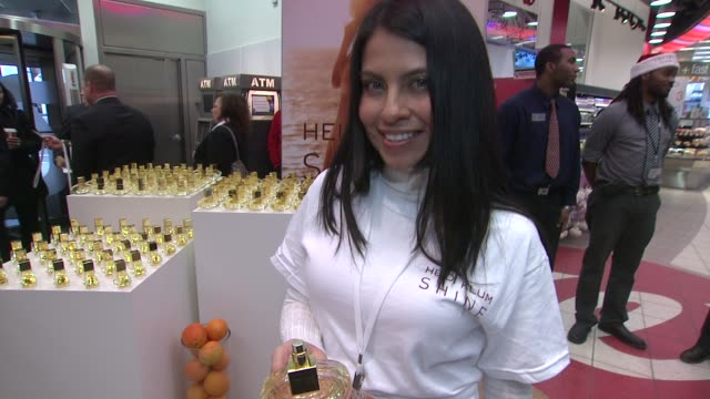participant with product at the Heidi Klum Celebrates Her Fragrance Shine At Walgreens Times Square at New York NY