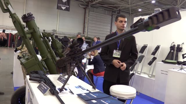 "participants and visitors attend the ""arms and security 2016"" exhibition in kiev, ukraine,11 october 2016. the xii international specialized... - security equipment stock videos & royalty-free footage"