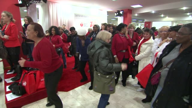 participants at aha's go red for women national wear red day at macy's at macy's herald square on 02/03/12 in new york - macy's herald square stock videos and b-roll footage