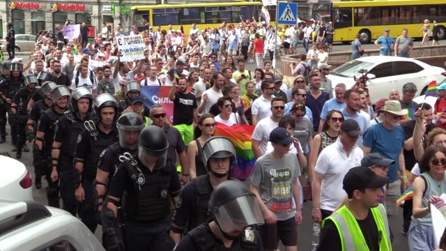 participants attend a gay pride march while police provide security, in kiev, ukraine, 23 june, 2019. several thousand people have taken part in... - lgbtqi点の映像素材/bロール