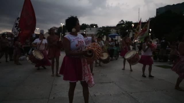 Participants celebrate at a preCarnival 'bloco' or block party on January 13 2017 in Rio de Janeiro Brazil