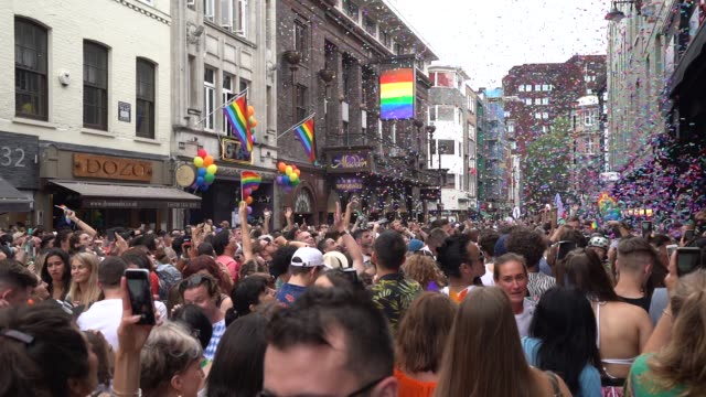 participants celebrate pride in old compton street during pride in london 2019 on july 6 2019 in london greater london - 2010年代点の映像素材/bロール