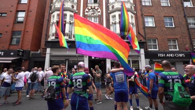 stockvideo's en b-roll-footage met participants celebrate pride in old compton street during pride in london 2019 on july 6, 2019 in london, greater london. - greater london
