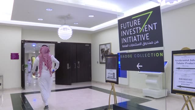 Participants collect their badges and accreditation at a key investment summit hosted by Saudi Arabia overshadowed by the killing of critic Jamal...
