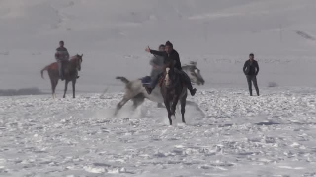 participants compete in the game of jereed on a snowcovered area in kekec village of kars province northeastern turkey on december 18 2018 jereed is... - kars stock videos & royalty-free footage