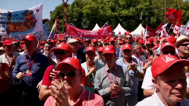 participants demonstrate at a protest organized by the ig metall trade union on june 29, 2019 in berlin, germany. ten thousand metal workers from all... - gewerkschaft stock-videos und b-roll-filmmaterial