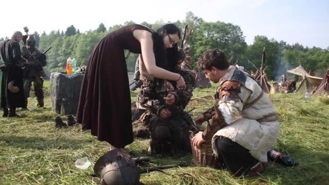 participants dressed as characters from 'the hobbit' book by j. r. r. tolkien, prepare for the reenactment of the 'battle of five armies' in a forest... - the hobbit: the battle of the five armies stock videos & royalty-free footage