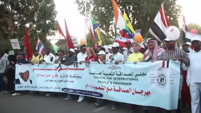 Participants from 86 countries march during the 4th International People's Friendship Festival organized by the Council for International People's...