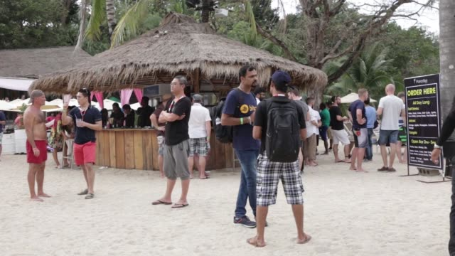Participants gather at a beach bar during a Coinsbank Blockchain Cruise Asia conference event at Paradise Beach in Phuket Thailand on Wednesday Jan...
