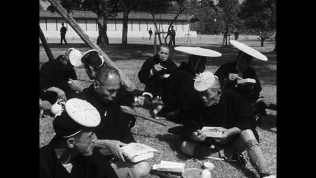 participants in jidai matsuri parade eat from bento boxes; 1964 - sitting on ground stock videos & royalty-free footage