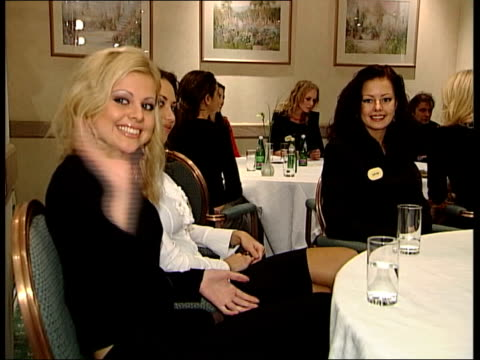 participants in london after nigeria violence; cf tape no longer available itn england: london: int miss world contestants sat at tables - ミス・ワールド点の映像素材/bロール