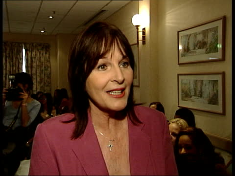 participants in london after nigeria violence; itn julia morley interview sot - competition is better now miss world contestants posing for photocall... - ミス・ワールド点の映像素材/bロール