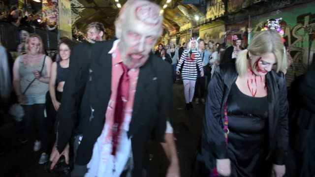 participants in zombie costumes and wearing zombie makeups take part at the event which runs in more than 50 cities across the globe during the world... - zombie stock videos & royalty-free footage