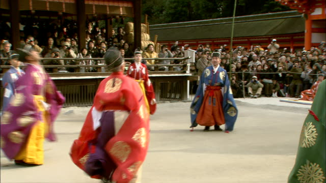 participants kick a football during kemari hajime at the shimogamo shrine. - ceremony stock videos & royalty-free footage