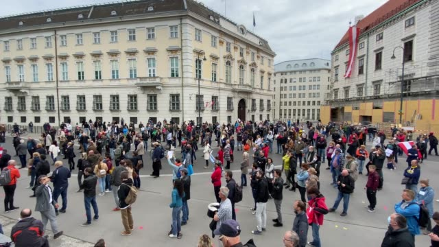 participants obey the rule to keep 1 metre distance during a demonstration against the government measures to slow down the spread of coronvirus... - questioni sociali video stock e b–roll
