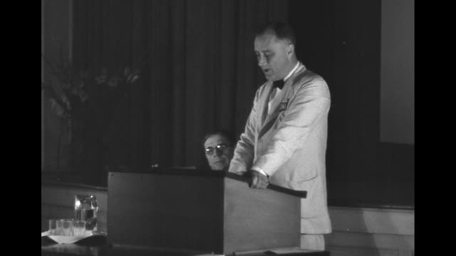 pan participants of conference standing outside building / gov franklin roosevelt in white suit reading as he stands with arms on lectern - 1929 stock videos & royalty-free footage