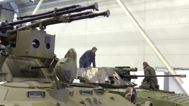 "participants of the exhibition stand on infantry fighting vehicle ""bmp-1t"" during ""arms and security 2016"" exhibition in kiev, ukraine,11 october... - security equipment stock videos & royalty-free footage"