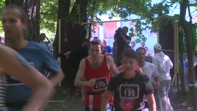 participants of the zombie run try to escape from a participant dressed as zombies and wearing zombie make-ups during the run in moscow, russia on... - participant stock videos & royalty-free footage