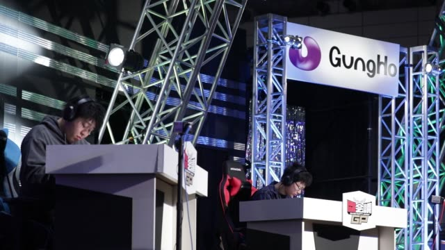 Participants play GungHo Online Entertainment Inc's Puzzle Dragons games during the Tokaigi Game Party Japan esports competition at the Makuhari...