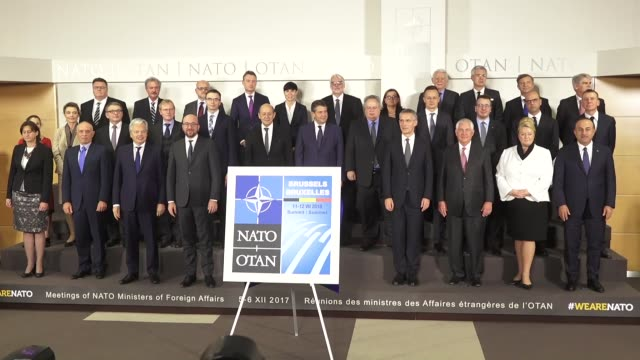Participants pose for a family photo during the NATO Foreign Ministers meeting at NATO headquarters in Brussels Belgium on December 05 2017
