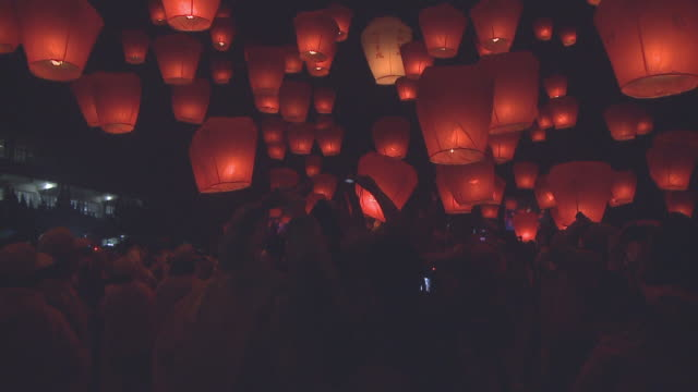 Participants release paper lanterns into the sky during a festival in Taipei, Taiwan.