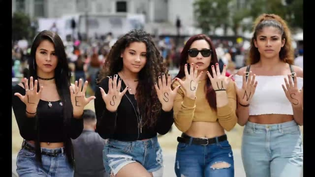 Participants seen with their hands spelling the phrase Less Guns More Love at March For Our Lives Los Angeles on March 24 2018 in Los Angeles...
