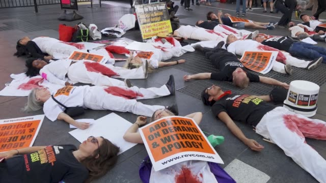 participants simulate being dead during a diein during a prolife supporters rally in times square manhattan new york city usa advocates rallied to... - enacting stock videos & royalty-free footage