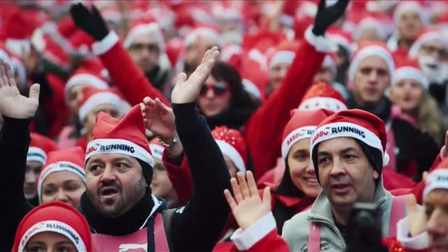 Participants Sunday warmed up for the second edition of the Babbo running a five kilometer non competitive race in Santa costumes in Milan CLEAN...