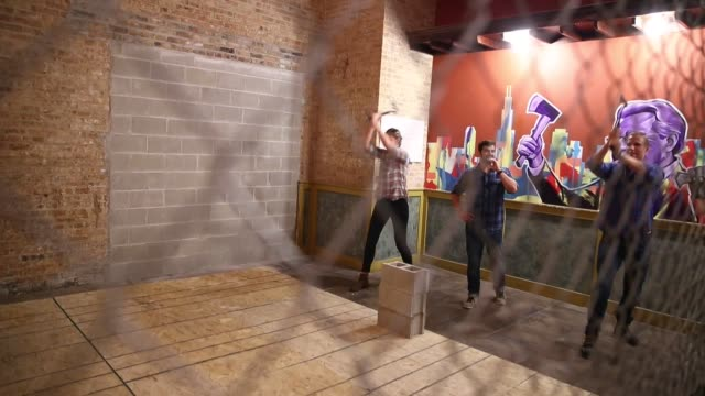 participants toss axes towards target at bad axe throwing an indoor axe throwing company in chicago illinois on september 30 2016 axethrowing which... - axe stock videos and b-roll footage