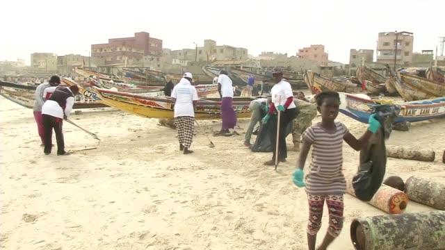participants volunteer at a beach cleanup in dakar, senegal - senegal stock videos & royalty-free footage