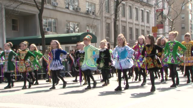participants wearing traditional irish costumes march in the 2012 st. patrick's day parade / bag pipers and musicians performing and marching in... - st. patrick's day stock videos & royalty-free footage