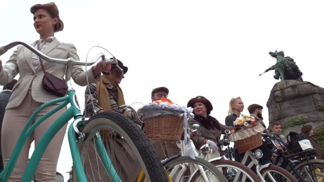 Participants with their bikes take part in the Tweed run cycle ride on the St Sophia Square in Kiev Ukraine08 October 2016 The participants dressed...