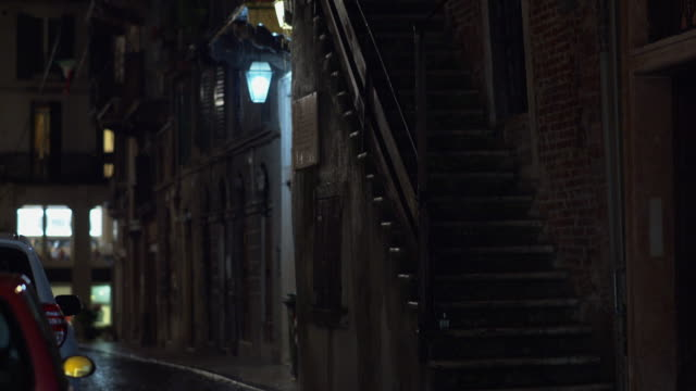 a particular outdoor stair under the rain at night in verona - cobblestone stock videos & royalty-free footage