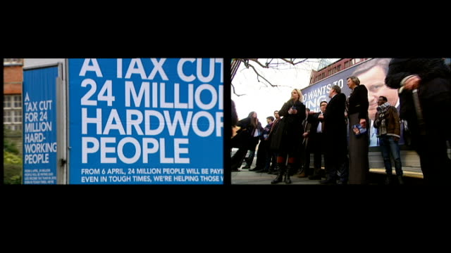 parties trade claims over beneficiaries of latest tax cuts; ext split screen mobile billboard carrying tory party poster driven along / balls and... - beneficiary stock videos & royalty-free footage
